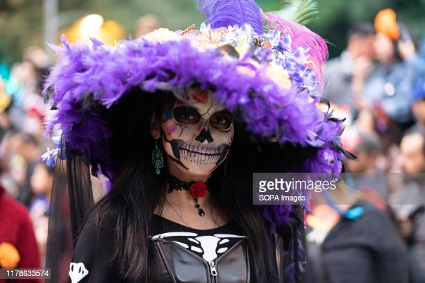A woman with her face painted seen during the Catrina Festival Thousands of people took to the streets of Mexico City to watch the procession of...