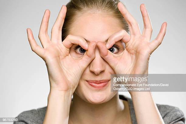 Woman with her hands around her eyes