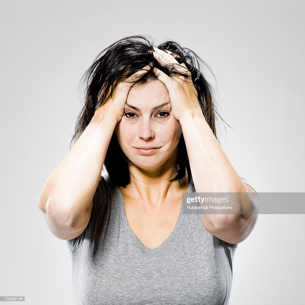 woman with her hands on her head : Stock Photo