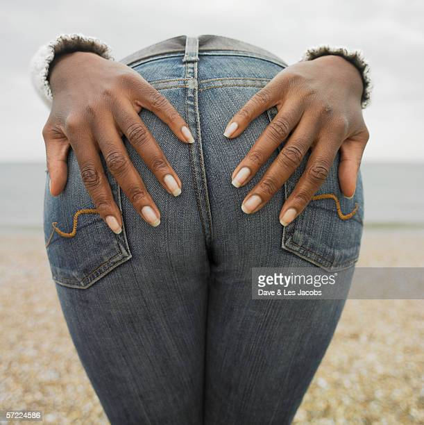woman with her hands placed on buttocks - bending over stock pictures, royalty-free photos & images