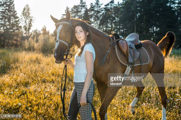 woman with her horse walking outdoors - dressage horse russia stock photos and pictures