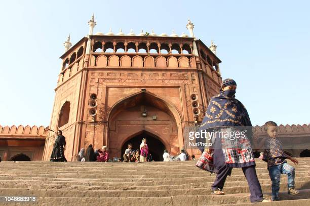 A woman with her kid can be seen on the stairs of Jamia Masjid in Old Delhi India on 6 October 2018