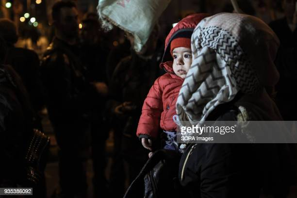 A woman with her kid seen at the demonstration Kurds living in Athens marched toward the Turkish embassy the protest against the war in Afrin