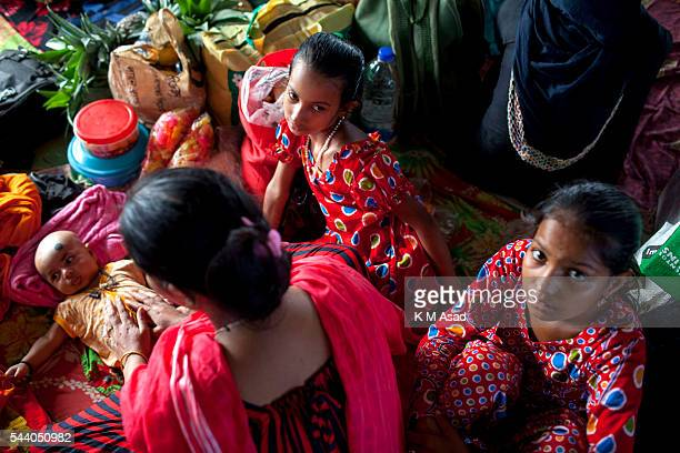 SADARGHAT DHAKA BANGLADESH Woman with her little children wait in a boat going to their village Bangladesh is one of the most densely populated...