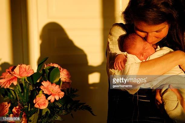 Woman with her newborn child