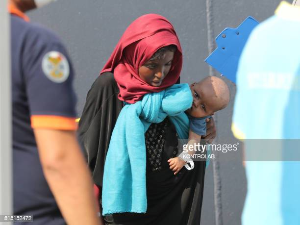 PORT CROTONE CALABRIA ITALY A woman with her son during the landing phases of Frontex's Olympic Commander vessel with 1200 African immigrants aboard...