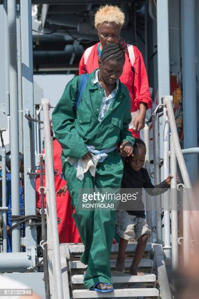 A woman with her son during the landing stages of migrants from the German military ship Rhein Refugees landed are 990 among them 203 unaccompanied...