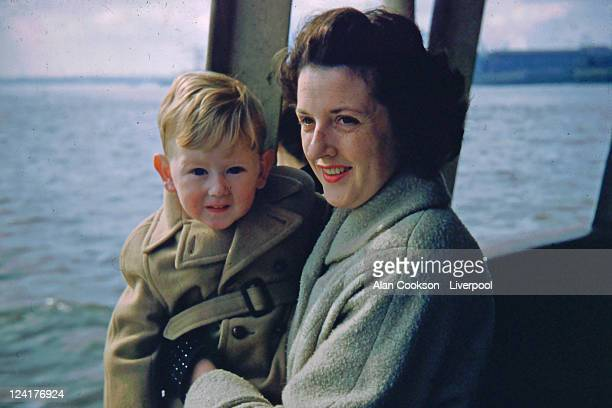 woman with her son sitting in boat - warm clothing stock pictures, royalty-free photos & images