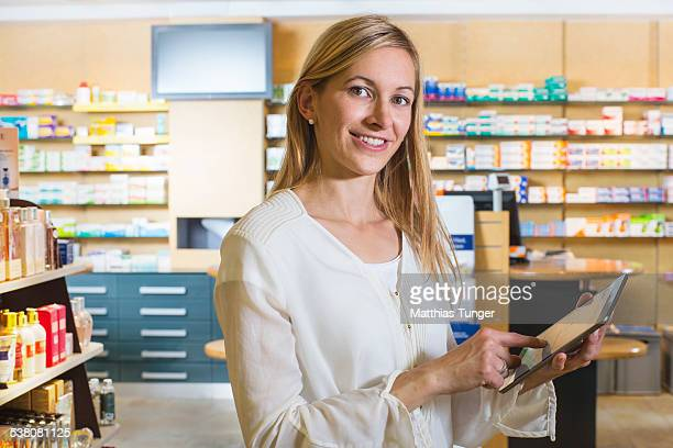 Woman with her tablet computer in the pharmacy