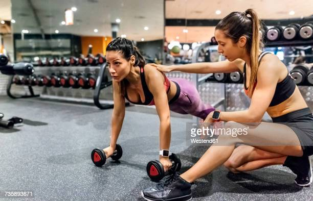 woman with her trainer working out in gym - コーチ ストックフォトと画像