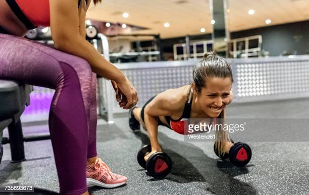 woman with her trainer working out in gym - clenching teeth stock pictures, royalty-free photos & images