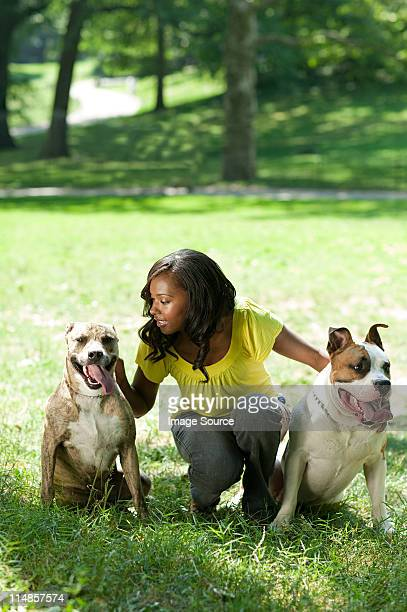 Woman with her two pet dogs
