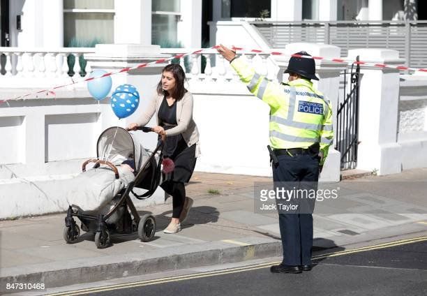 A woman with her young child leaves the police cordon at Parsons Green Underground Station on September 15 2017 in London England Several people have...