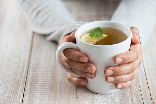 Woman with herbal tea 928034704