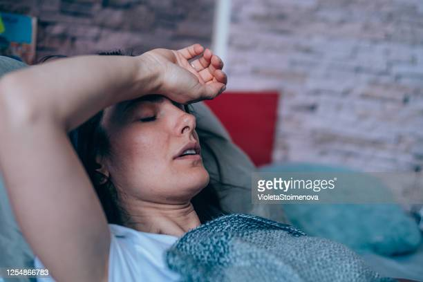 woman with high fever at home. - exhaustion stock pictures, royalty-free photos & images