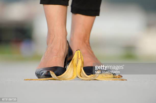 Woman With High Heels Standing In Front Of Banana Peel