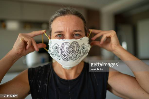 woman with homemade mouth nose mask looking at camera - nose mask stock pictures, royalty-free photos & images