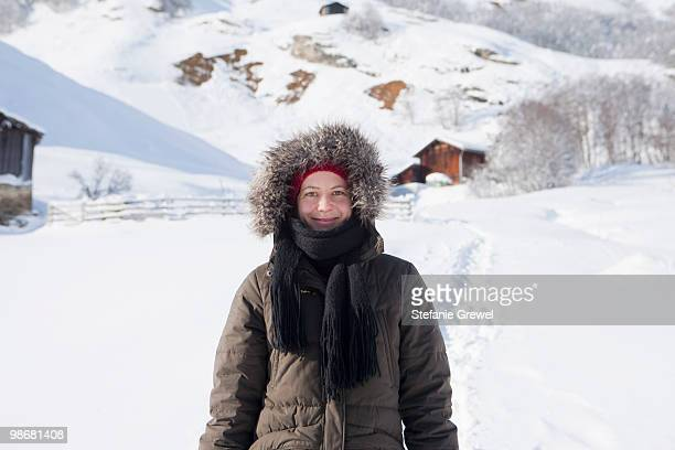 woman with hooded jacket - parka coat stock photos and pictures