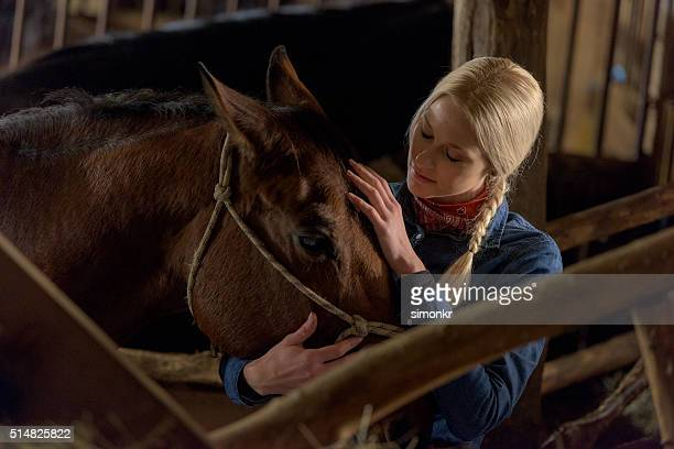 woman with horse - cowgirl hairstyles stock photos and pictures