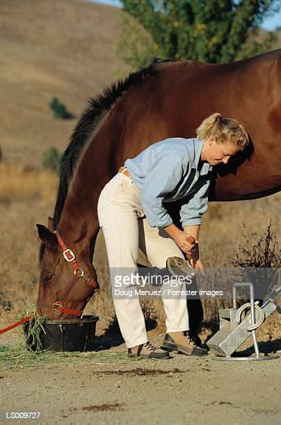 Woman With Horseshoe Kit