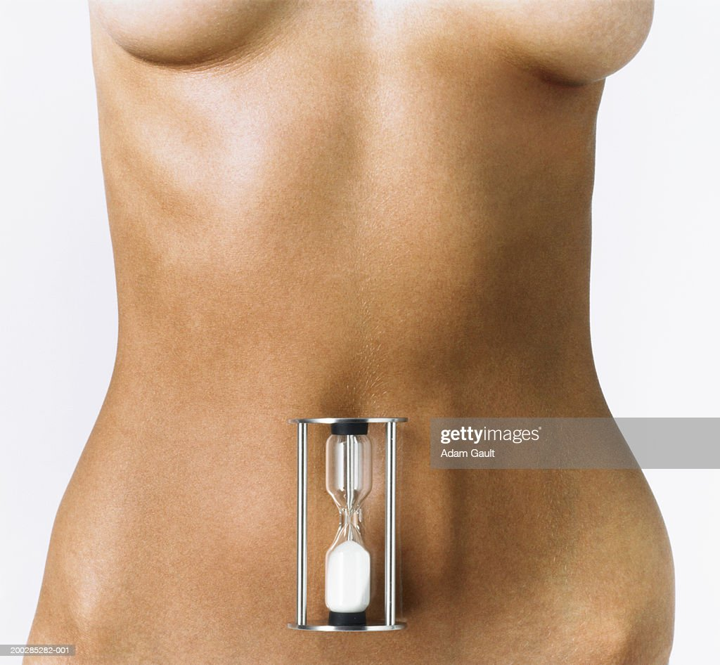 Woman with hourglass on abdomen, mid section : Stock Photo