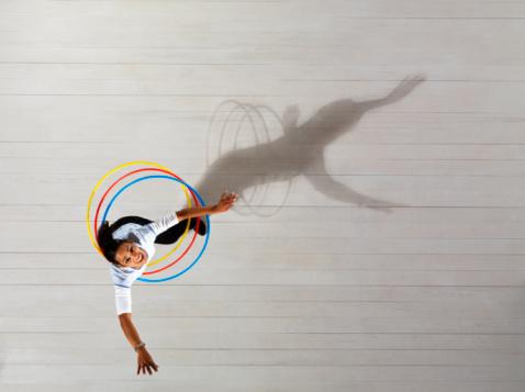 Woman with hula hoops - gettyimageskorea