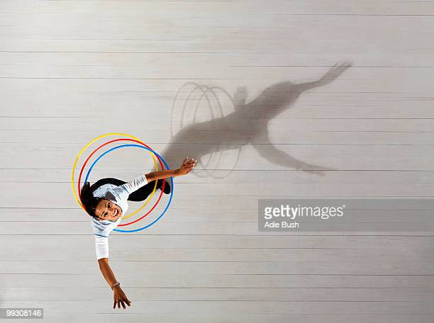 woman with hula hoops - three objects stock pictures, royalty-free photos & images