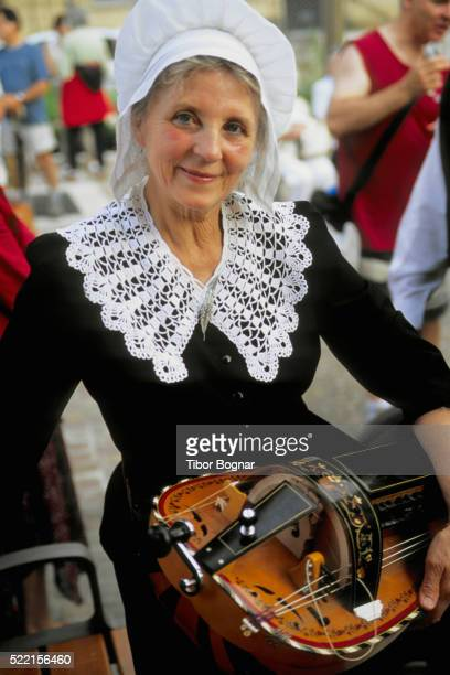 woman with hurdy-gurdy - bastille day stock pictures, royalty-free photos & images