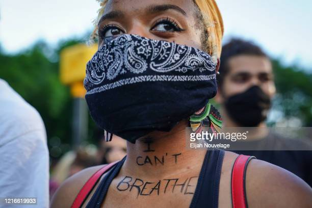 A woman with 'I can't breathe' written on her neck is seen during a demonstration on May 31 2020 in Atlanta Georgia Across the country protests have...