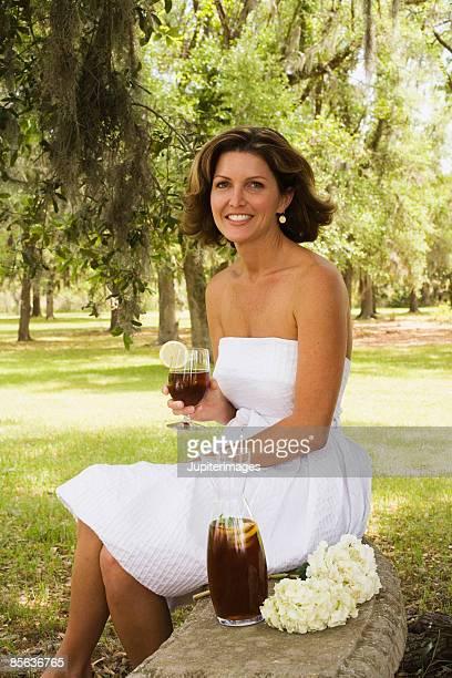 woman with iced tea - vestito senza spalline foto e immagini stock