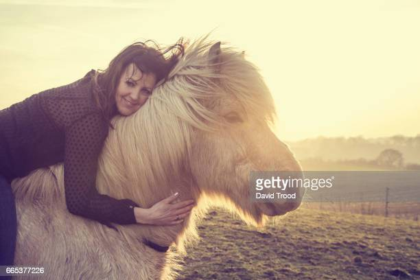 Woman with Icelandic pony