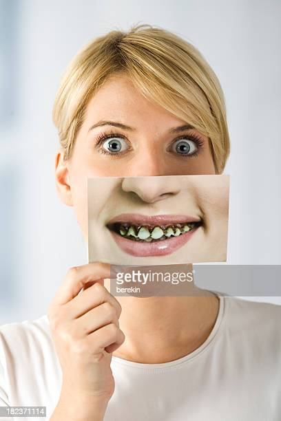 woman with image of rotten teeth - dental fear stock pictures, royalty-free photos & images