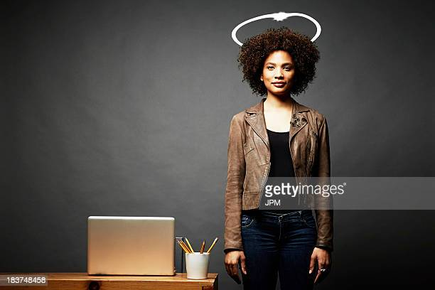 woman with imaginary angel halo - angel halo stock pictures, royalty-free photos & images