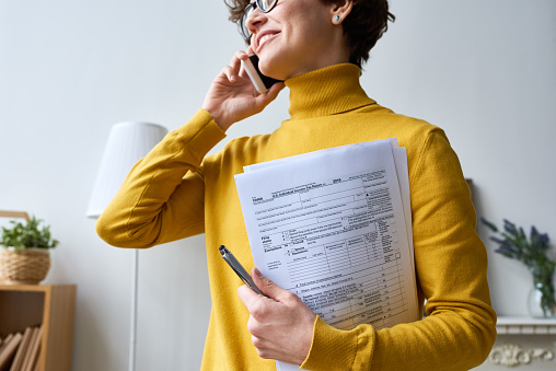 Woman with individual income tax return form 1131867646