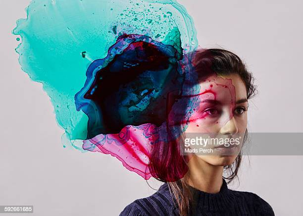 woman with ink in front of her face