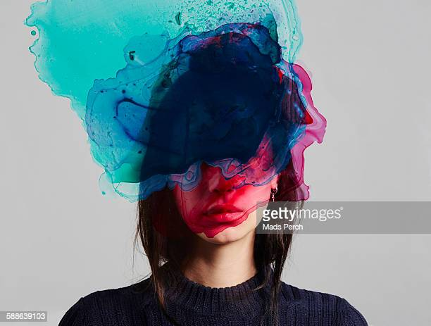 woman with ink over her face - creativity stock-fotos und bilder