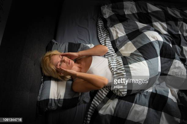 woman with insomnia, in bed. - inconvenience stock pictures, royalty-free photos & images