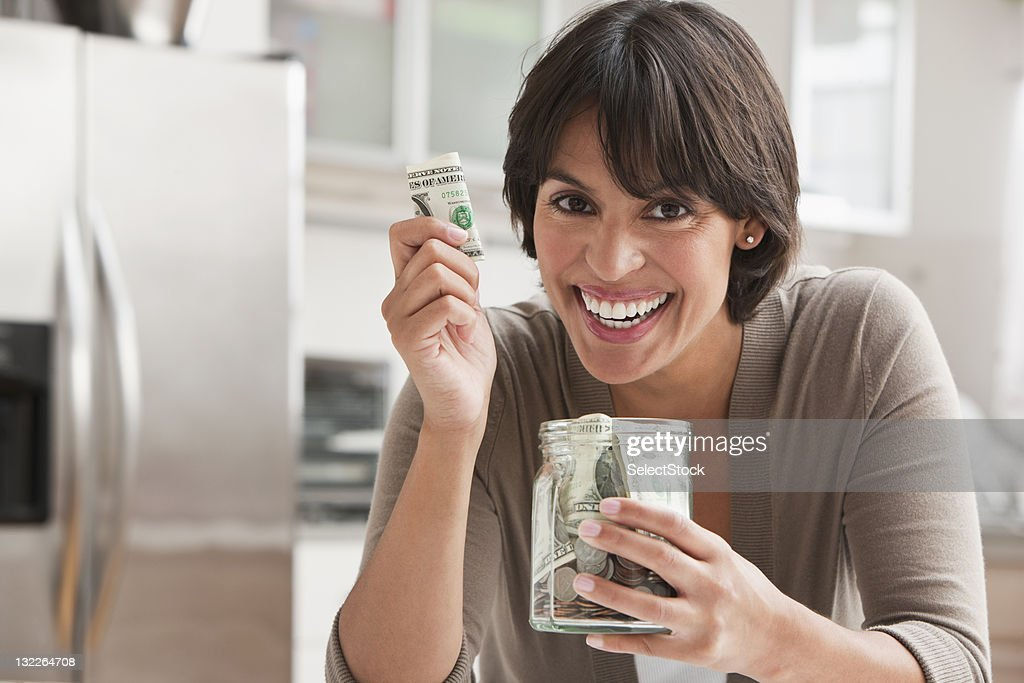 Woman with jar of cash : Stock Photo