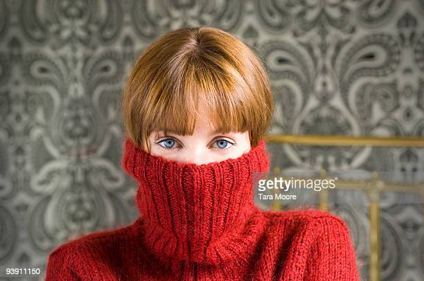 woman with jumper pulled over face - turtleneck stock pictures, royalty-free photos & images