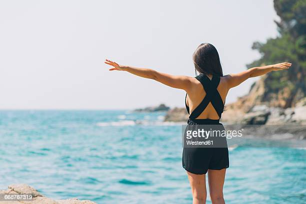 Woman with jumpsuit on the beach