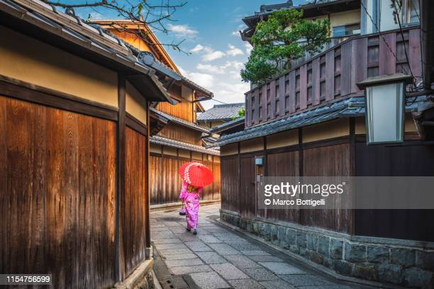 woman with kimono walking in the old town of kyoto, japan - 京都市 ストックフォトと画像
