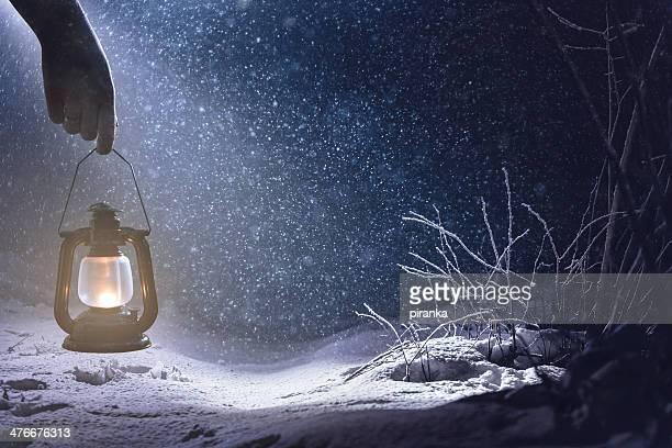 Woman with lantern on a snowy night