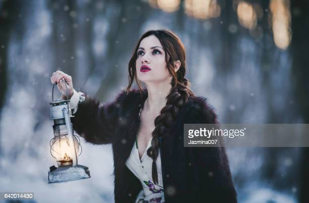 woman with lantern - princess stock pictures, royalty-free photos & images