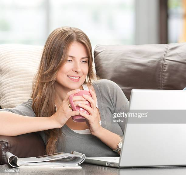 Woman with laptop at home.