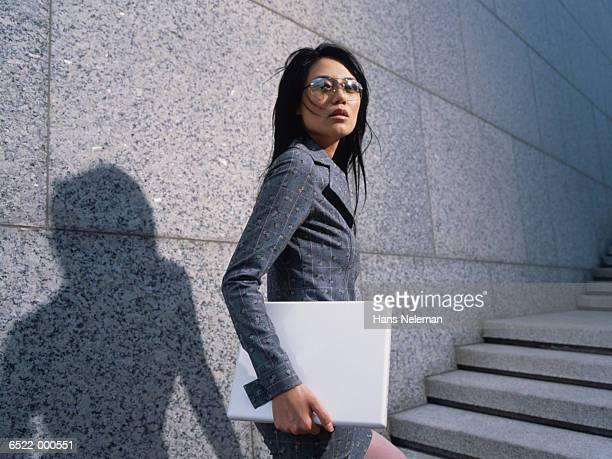 woman with laptop computer - turning stock pictures, royalty-free photos & images