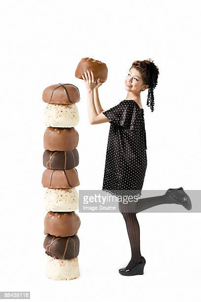 Woman with large chocolates