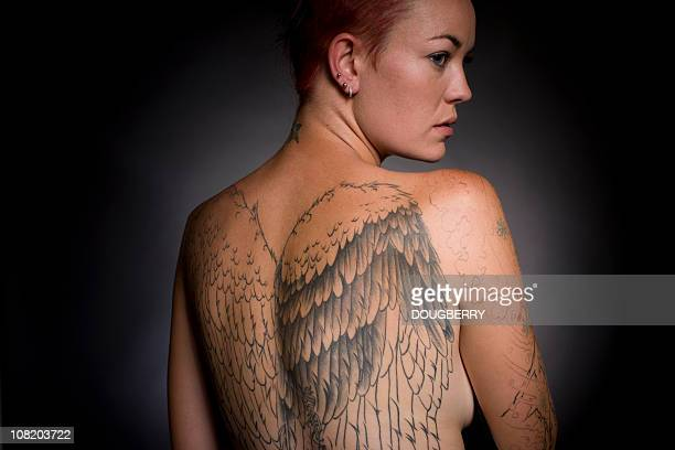 Woman with large Tattoo on her Back
