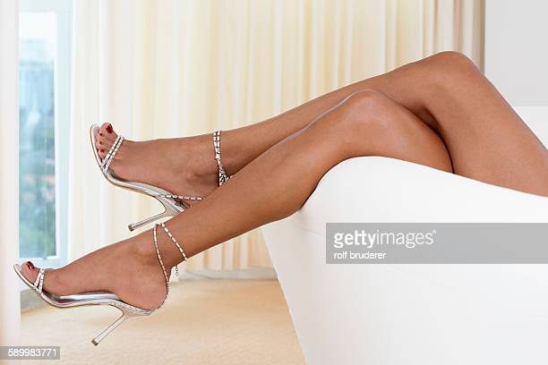 Woman with Legs Up on Sofa