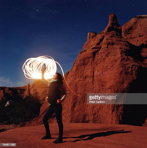 Woman With Light Coming From Her Fist