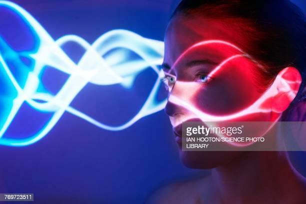 woman with lights on face - calculating stock pictures, royalty-free photos & images